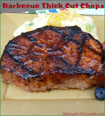 Barbecue Thick Cut Chops, rubbed, marinated and grilled these thick pork chops have big bold flavor. | Recipe developed by www.BakingInATornado.com | #cook #dinner