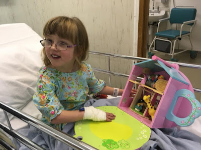 Jessica sitting on her theatre trolley ready to go in for her op