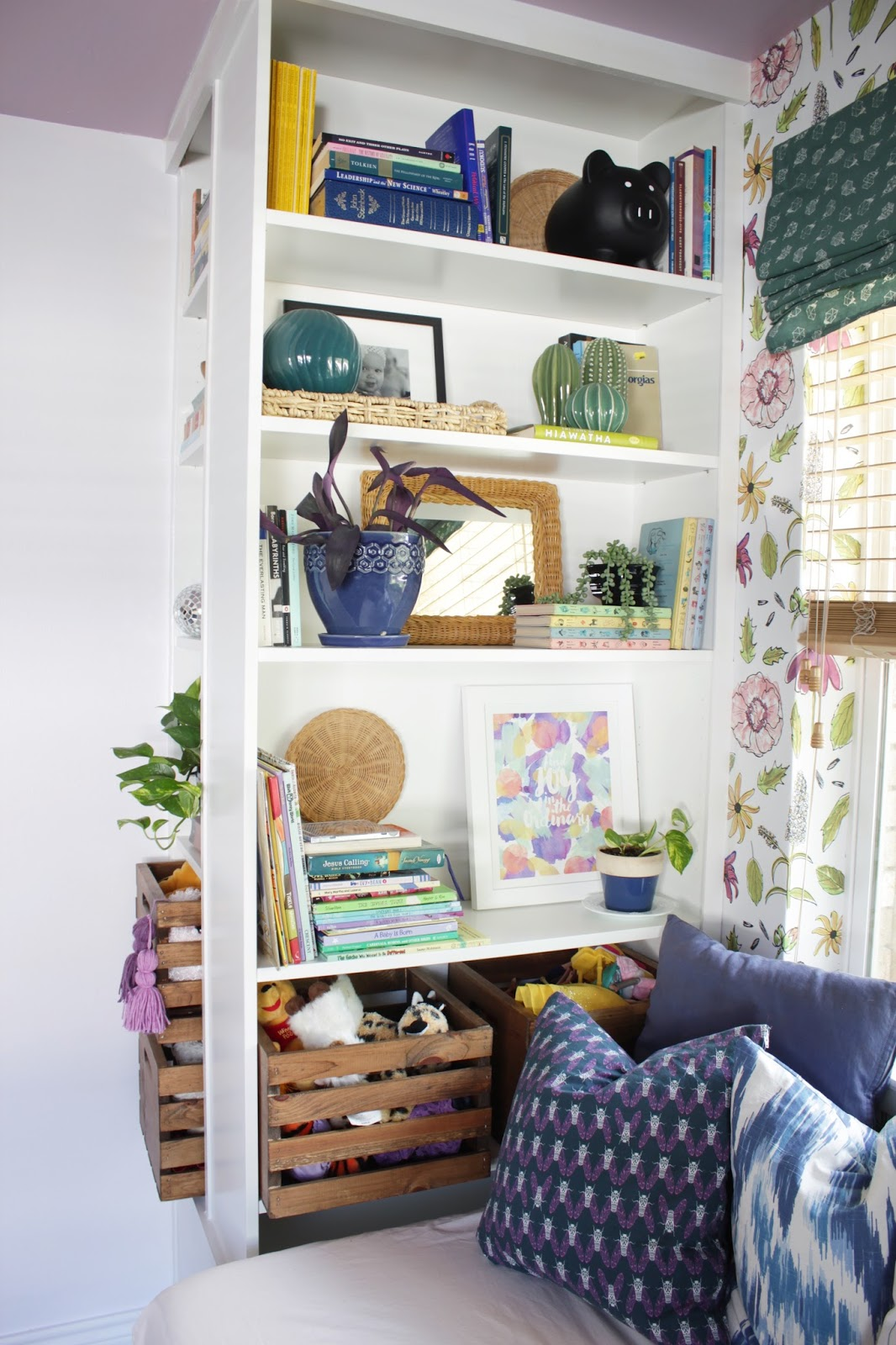 These wooden crates are a great, sturdy option for toy storage. See how I made them bookshelf ready!