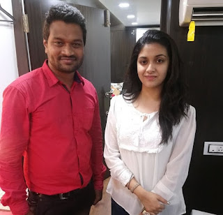 Keerthy Suresh in White Dress with Cute and Awesome Lovely Smile with a Lucky Fan