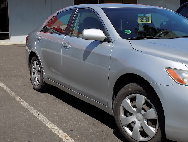 Damaged Camry after collision repair at Almost Everything Auto Body.
