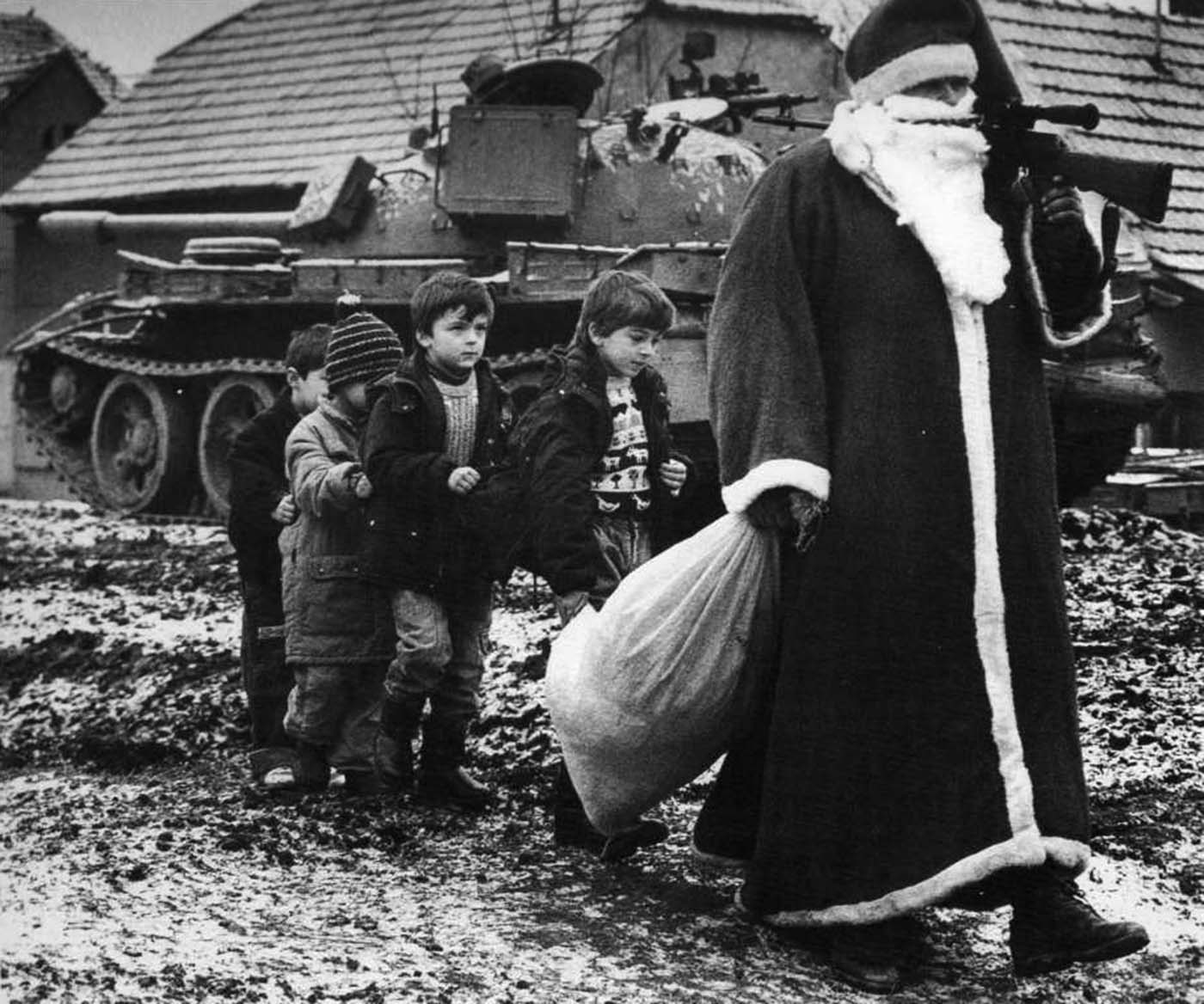 Santa Claus with the children during Croatian War of Independence. Vukovar, 1992.