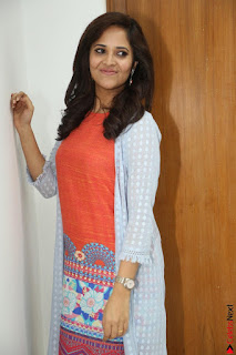 Actress Anasuya Bharadwaj in Orange Short Dress Glam Pics at Winner Movie Press Meet February 2017 (65).JPG