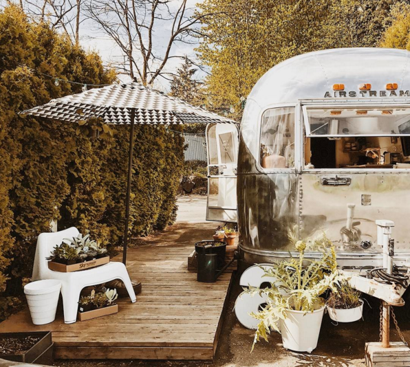 all silver vintage airstream with a beautiful outdoor patio area