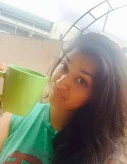 Keerthy Suresh in Green T-shirt with Cute and Awesome Lovely Expressions While Drinking Coffee