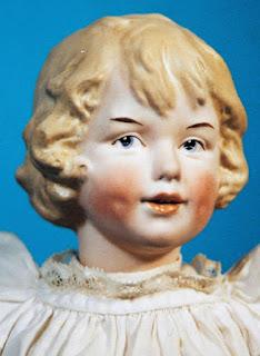 Cabeza de Heubach Baby Piano Doll