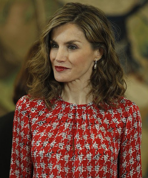 Queen Letizia wore Carolina Herrera blouse, UTERQUE High heel fabric shoes, Hugo Boss Trousers