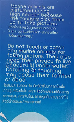 a photo of sign to make people aware of not picking up marine creatures