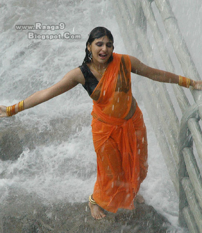 Mounica In Wet Saree Hot Hot Images With Transparent Green