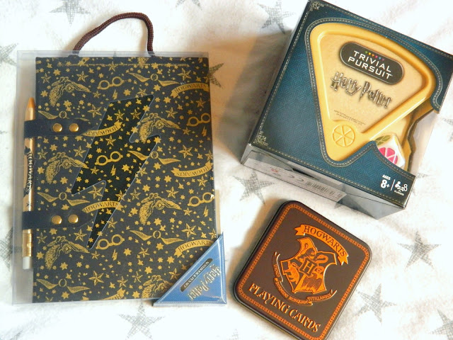 A Harry Potter notebook and pen set, Harry Potter trivial pursuit game, Harry Potter playing cards in a themed tin,