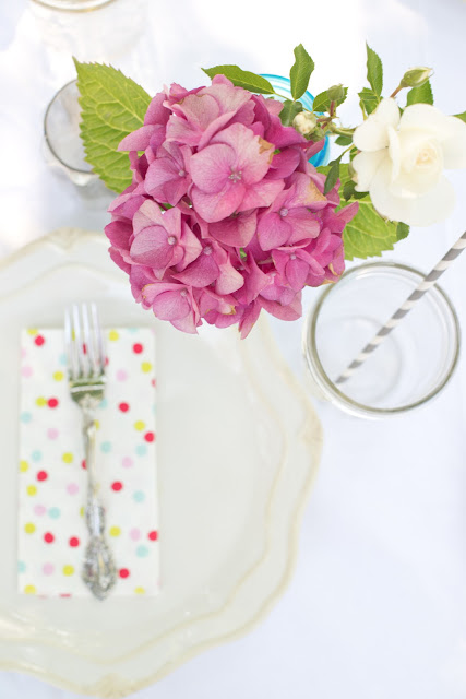 Pink hydrangeas, polka dot napkins, and paper straws!  Such a cute and simple tablescape!