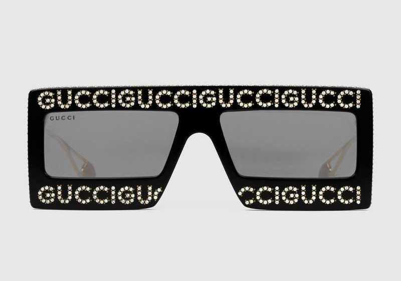 78f237f028 Occhiali da sole a mascherina Gucci in acetato nero lucido e cristalli