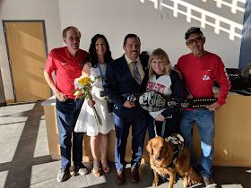 The happy couple along with their families, and the CUE Championship belt!