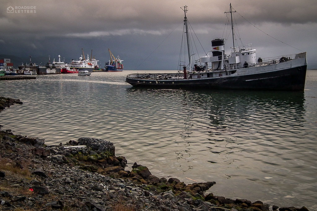 Heavy clouds over destroyed ship in the port of Ushuaia
