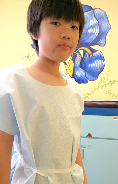 kids doctors gown ready to be examined