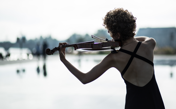 artistic photography of a fashion blogger playing violin