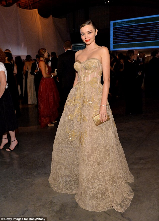 Miranda Kerr is flawless in a gold gown at the Baby2Baby Gala in California