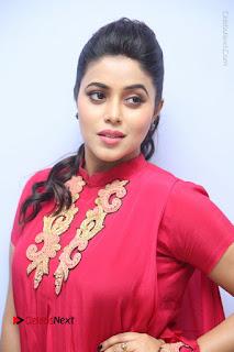 Actress Poorna Latest Stills in Red Dress at Rakshasi First Look Launch  0022.JPG