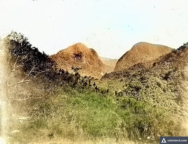 In the absence of roads, American soldiers had to hike over mountains during the Fil-Am War.  Image source:  Fort Worth Library.  Colorized courtesy of Algorithmia.