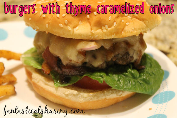 Burgers with Thyme Caramelized Onions // These burgers have thyme caramelized onions sealed between two pieces of cheese and are smothered in garlic mayo...nothing better than that! #recipe #burgers #beef #maindish