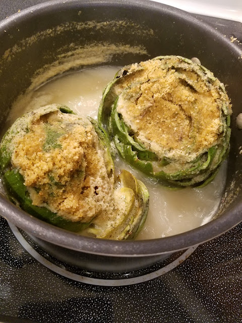 These are homemade stuffed artichokes with Italian bread crumbs, cheese and garlic. They are cleaned boiled and stuffed