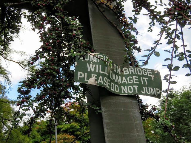 Warnng sign on the suspension bridge in Mount Usher Gardens in County Wicklow