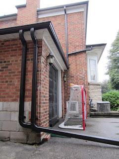 Double downpsout downpipe Toronto eavestrough rain