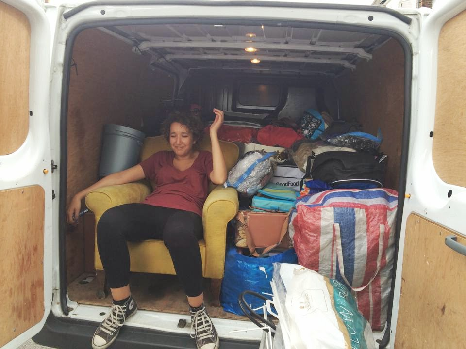woman sat in moving van