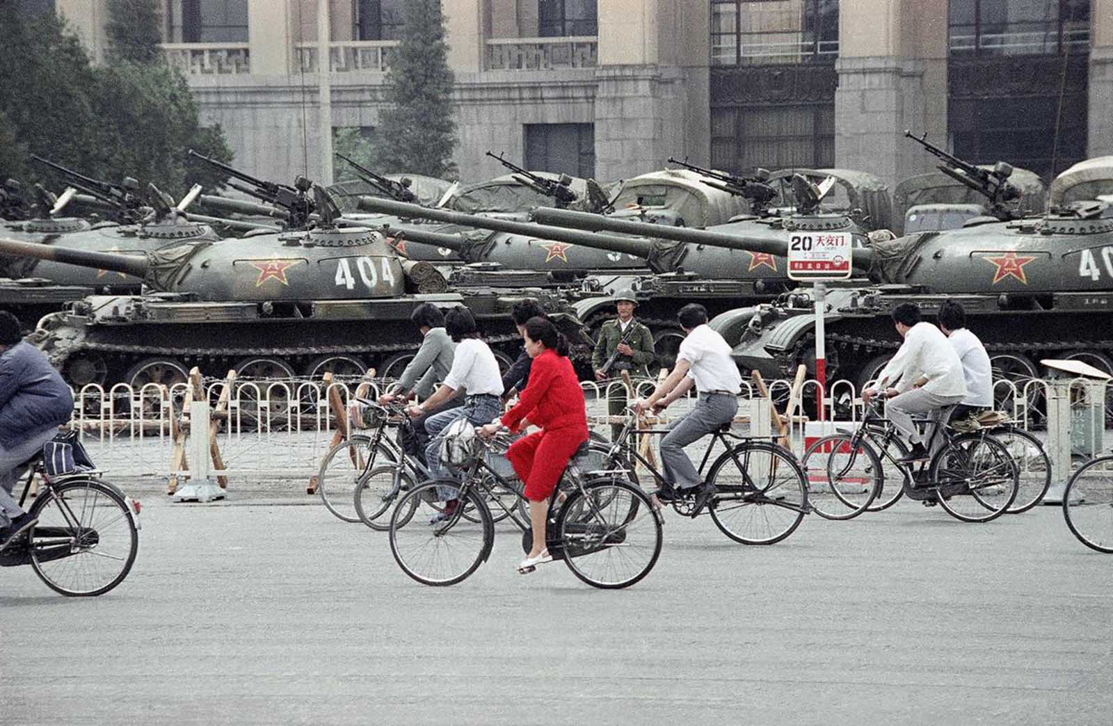 A wall of tanks and APCs greet bicycle commuters near Tiananmen Square, on June 13, 1989, in Beijing.