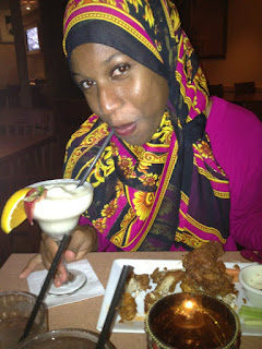 Black Muslim Woman Eating