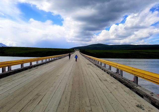 Kids walking on the bridge over Susitna River