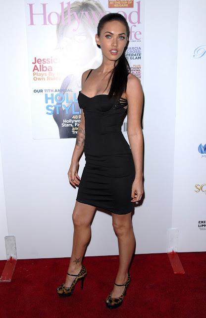 Foxy Megan: Megan Fox in a tight black dress
