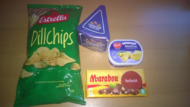 Dillchips, Streichkäse, Knäckebrot und Haselnuss Schokolade.