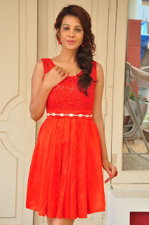 Diksha Panth in a lvoely Red Short Dress at Kavvintha Movie Press Meet