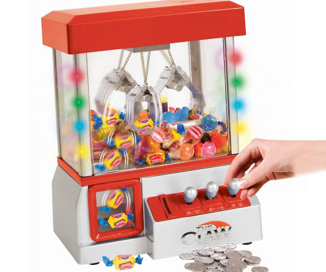 Bring carnival fun right to your bedroom with this mini electronic claw game. This pint-sized version of the classic claw game measures 10″L x 7.5″W x 13.5″H and can be filled with a variety of different sugary treats. And best of all it's not rigged to just steal your money!
