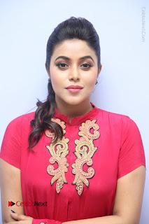 Actress Poorna Latest Stills in Red Dress at Rakshasi First Look Launch  0008.JPG