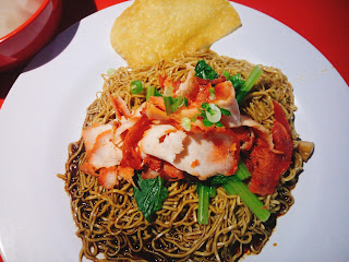 Char Siew, greens, Fried Wan Tan Skin on top of each serving of Wan Tan Mee