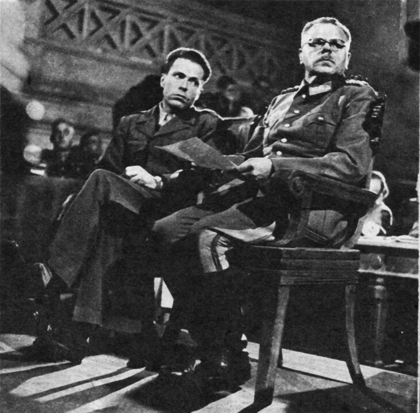 Dostler (right) with his interpreter, Albert O. Hirschman, at his trial.