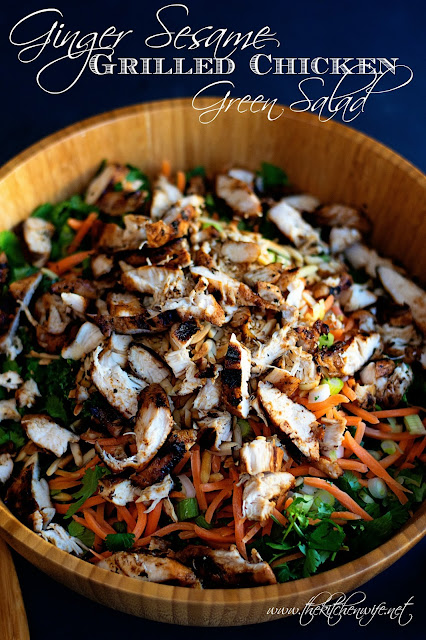 A bowl of the finished ginger sesame grilled chicken green salad with the title above it.
