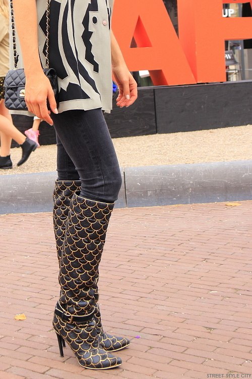 fashion week amsterdam street style fashion of long boots with high heels