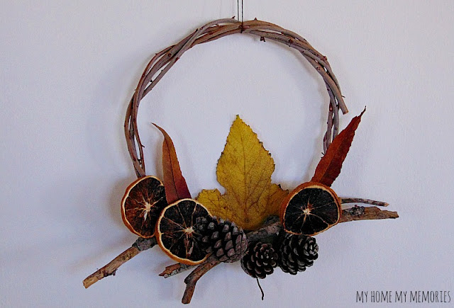 diy-wreath-with-dried-leaves-orange-slices-pinecones-for-autumn