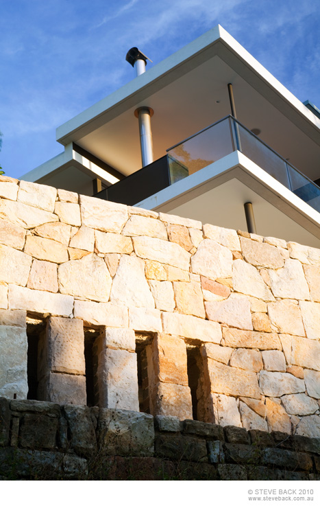 Stone wall of the River House by MCK Architects
