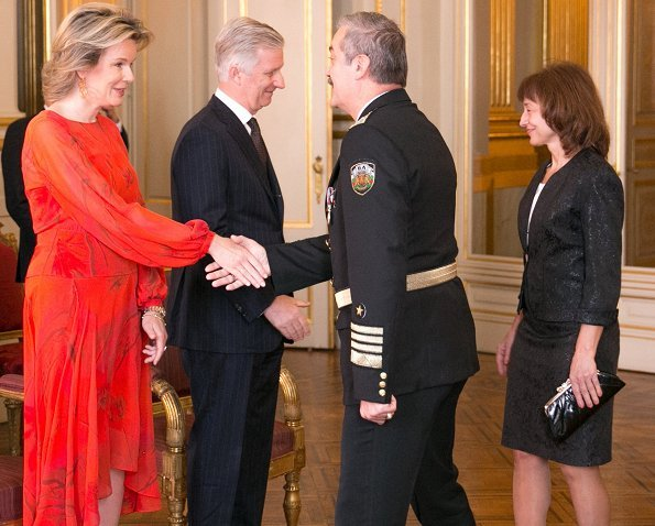 Queen Mathilde wore Natan silk print dress. Queen Mathilde wore a red silk midi dress by Natan. gold earrings