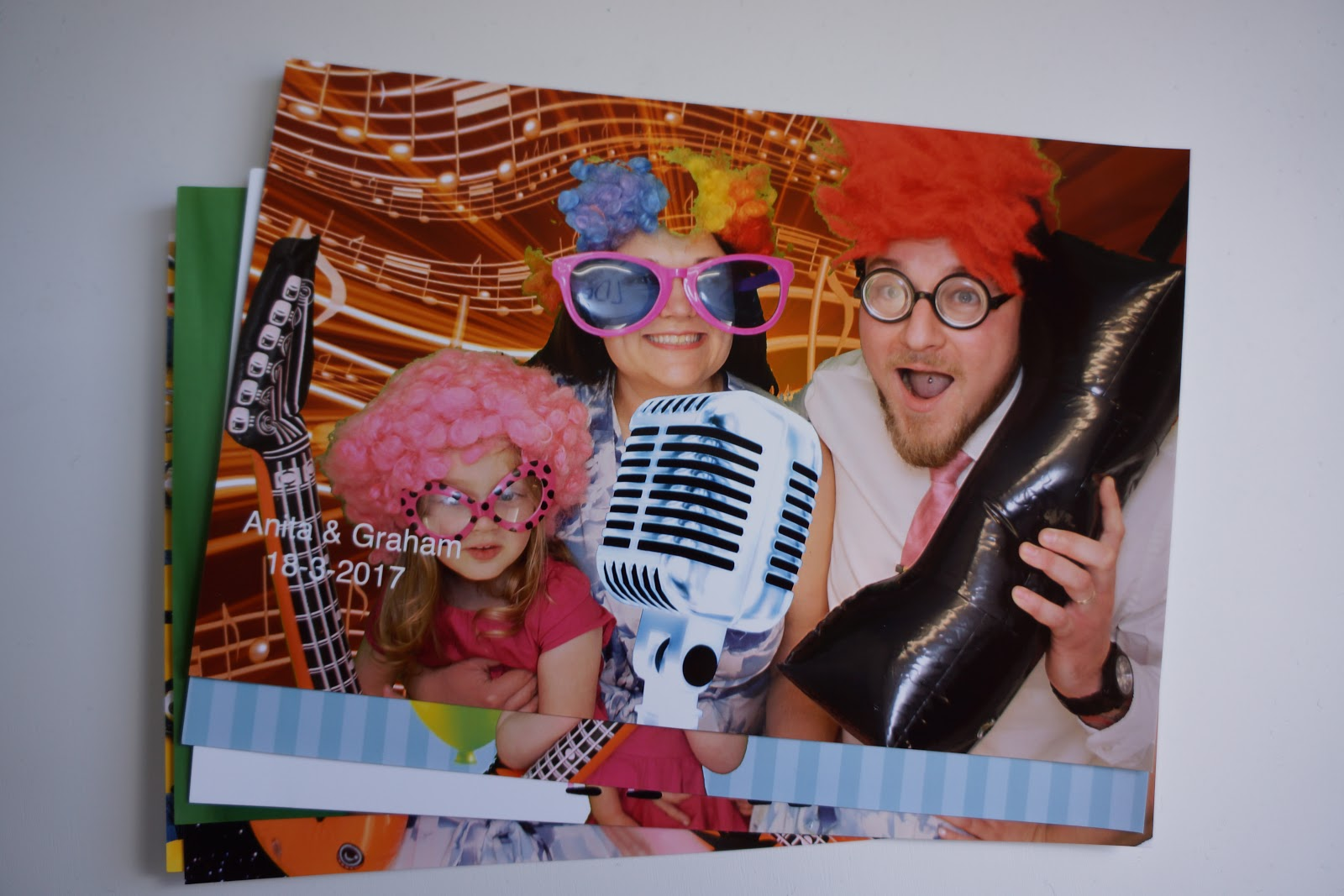 a funny family picture at a photo booth with everyone dressed as rockers