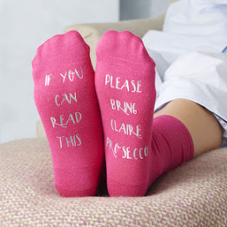 http://www.notonthehighstreet.com/alphabetinteriors/product/personalised-please-bring-prosecco-socks
