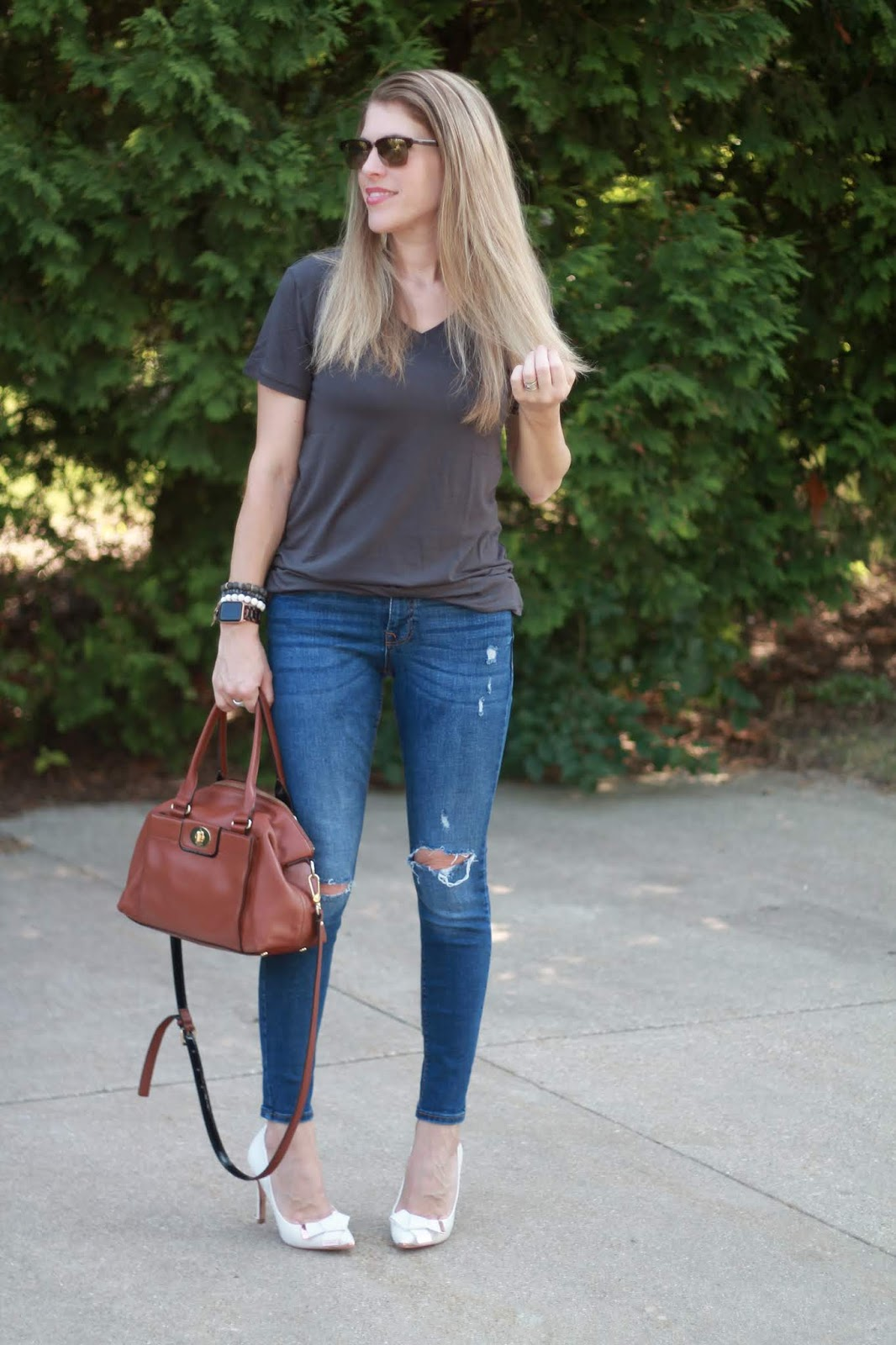 grey tee, distressed jeans, white heels, white beaded tassel earrings