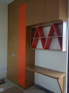 Wardrobe with a small study table