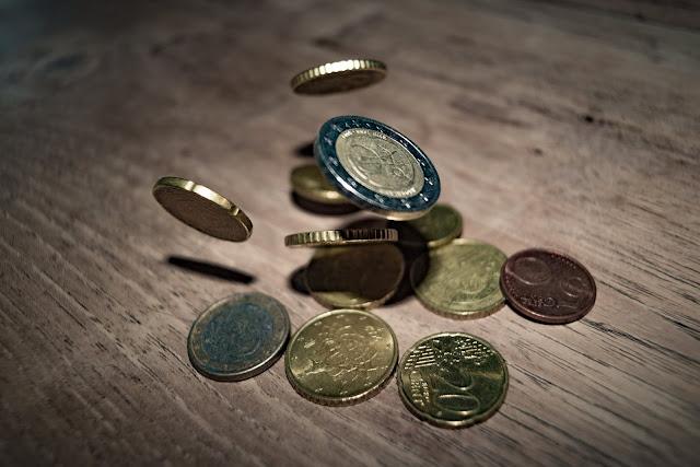 bermaian dengan uang Koin