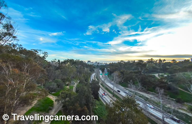 There is a beautiful walk from San Diego Zoo towards Downtown through Balboa Park and as you exit main gate of Balboa park, you cross a bridge which offers above view of the highway which goes towards Los Angles.