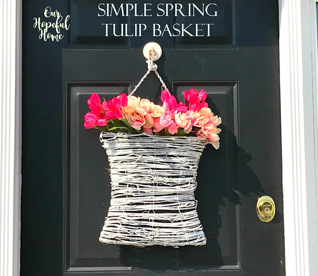 black front door white hanging basket faux tulips flowers